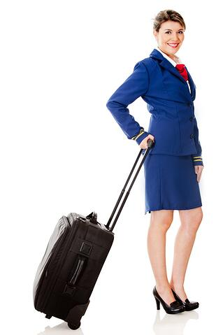 Air hostess with a bag - isolated over a white background.jpeg