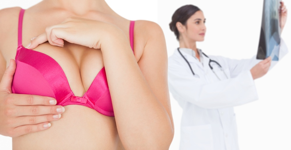 Composite image of closeup of woman performing self breast examination.jpeg