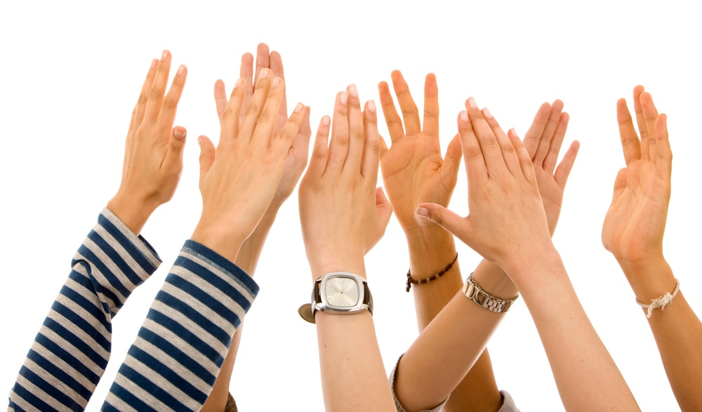 many hands of participation isolated over a white background.jpeg
